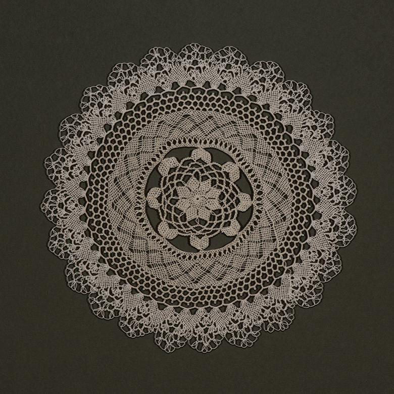 An Armenian needle lace artwork by Karoun Elizabeth Arslanian, depicting how the gospel binds her family together.