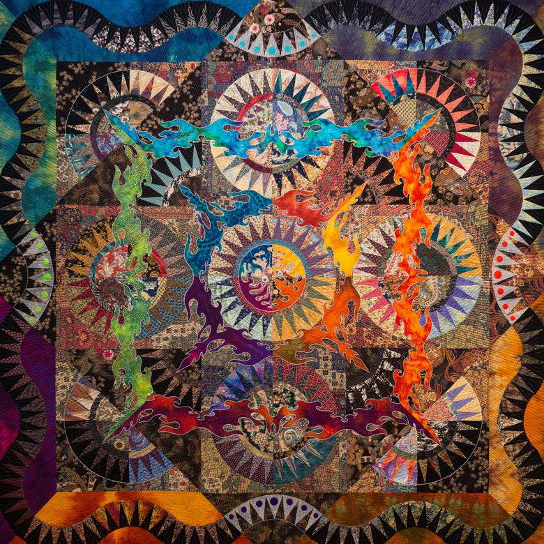 A textile by Kazuko Covington depicting worlds without end.