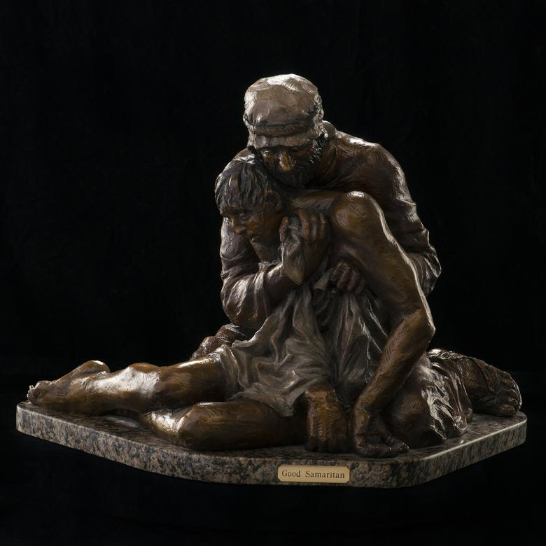 A bronze sculpture by Allen Jay Haroldsen depicting the Good Samaritan.