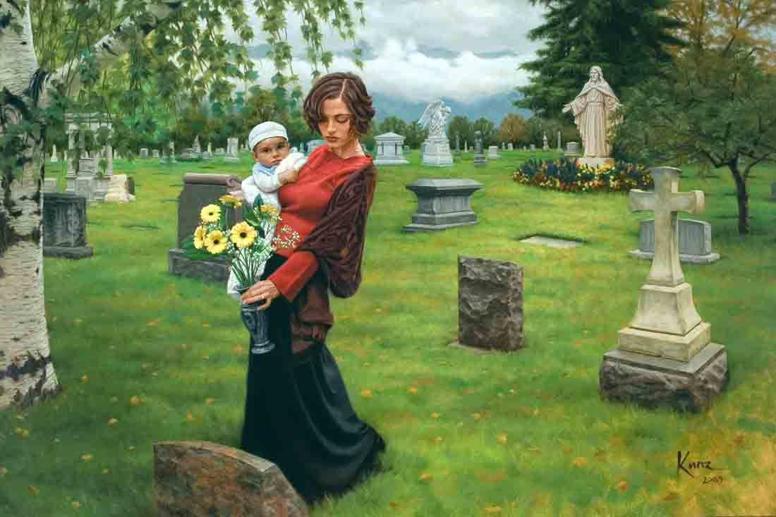 Women honoring deceased loved one at grave
