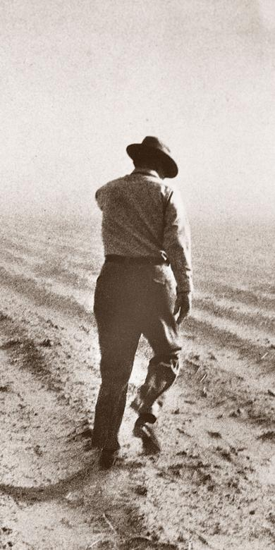 Ezra Taft Benson inspecting a farm during a drought