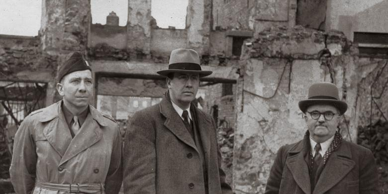 Ezra Taft Benson and others inspect damage in Freiberg, Germany, after World War II