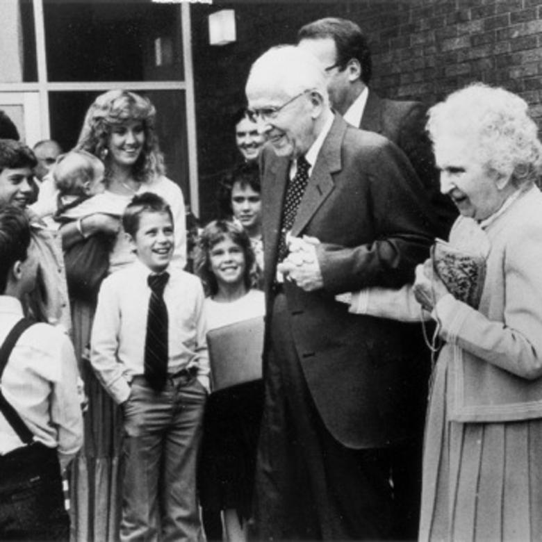 President and Sister Benson greet a group of children circa 1986.
